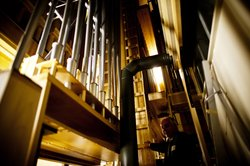 Jacquelin Rochette, artistic director of Casavant Bros., gives a tour of the labyrinthine organ chamber. The Montreal-based company was founded in 1879 and specializes in building, renovating and installing pipe organs.