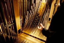 Pipes inside the organ chamber range from five-eighths of an inch to 32 feet long, with varying shapes and diameters. Each pipe is meticulously tuned to create the organ&#39;s unique tonality.