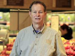 "Whole Foods co-CEO John Mackey, pictured in 2009, says big businesses have an obligation to change customers' perception that corporations are ""primarily selfish and greedy."""