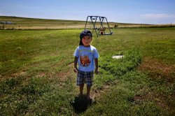 Derrin Yellow Robe, 3, stands in his great-grandparents' backyard on the Crow Creek Reservation in South Dakota. He was taken off the reservation by South Dakota's Department of Social Services in July 2009 and spent a year and a half in foster care before being returned to his family.