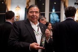 Marshall McKay, Tribal Chairman of Yocha Dehe Winton Nation, displays a bottle of his premium SÉKA HILLS Extra Virgin Olive Oil from Capay Valley, Calif. Capay Valley is an agricultural region with a climate similar to the Mediterranean providing an ideal environment for cultivating olive groves.