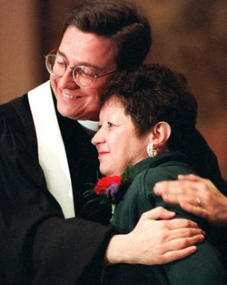 Norma McCorvey, the &quot;Jane Roe&quot; of the 1973 decision, embraces the Rev. Robert L. Schenck of the National Clergy Council before she addresses a memorial service at Georgetown University in Washington, D.C., on Jan. 21, 1996. A year earlier McCorvey shocked abortion-rights advocates by becoming a spokeswoman for the other side of the debate, stating she no longer supported abortion rights.
