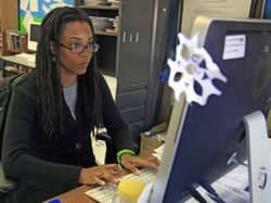 Nkomo Morris, a teacher at Brooklyn&#39;s Art and Media High School, works on her classroom computer in New York.