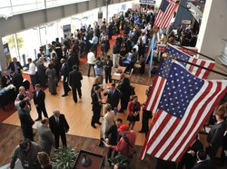 Hundreds of veterans and military spouses meet with prospective employers at the Hiring Our Heroes job fair at Nationals Park in Washington, D.C., in December. Veterans say they&#39;re still having trouble finding jobs and getting other types of assistance.
