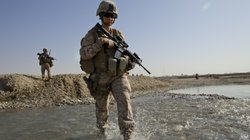 U.S. troops in Afghanistan appear to have mixed feelings about the decision lifting the ban on women in combat positions. Some women already operate in combat zones. Hospital Corpsman Shannon Crowley is shown here with her Marine Corps team in Musa Qala, Afghanistan, in November 2010.