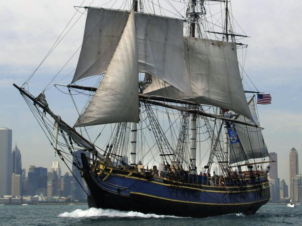 The HMS Bounty replica sails past the Chicago skyline in July 2003.