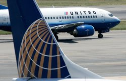 A United Airlines aircraft passes by a Continental Airlines plane at Ronald Reagan National Airport in 2006. Their merger, begun in 2010, has been difficult, analysts say.