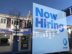 The job market showed strong growth in February. But questions about low wages, consumer debt and government austerity cloud the sunny picture.