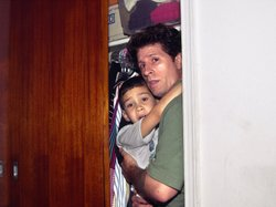 Fisherman Donato Dalrymple holds 6-year-old Elian Gonzalez inside a bedroom closet moments before federal agents entered the bedroom on April 22, 2000, and seized the boy to reunite him with his father in Washington.