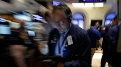 Trader Warren Meyers works on the floor of the New York Stock Exchange on Friday. Stocks opened higher after the government reported a burst of hiring last month that sent the unemployment rate to a four-year low. But both the White House and congressional Republicans reacted to the news in less than celebratory fashion.