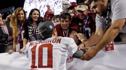 Katherine Webb (left), the girlfriend of Alabama quarterback A.J. McCarron, and McCarron&#39;s mother, Dee Dee Bonner (second from left), watch McCarron celebrate after the BCS National Championship college football game on Jan. 7. Webb was caught on camera and announcer Brent Musburger enthusiastically remarked that quarterbacks &quot;get all the good-looking women.&quot; ESPN later apologized.