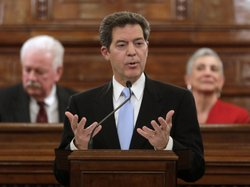 Kansas Gov. Sam Brownback, shown delivering the State of the State address last month, is pushing to get rid of the state&#39;s income tax, which has some Republicans concerned.