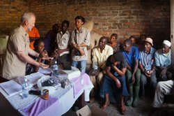 "Shawn Askinosie, founder of Askinosie Chocolate, buys cocoa beans directly from farmers, like this Uwate cocoa farmers group in Tenende, Tanzania. Dealing direct ""impacts the flavor of coffee, and it brings the consumers closer to the producers,"" Askinosie says."