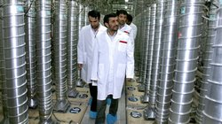 Iranian President Mahmoud Ahmadinejad (center) visits an uranium enrichment facility in Natanz, Iran, in 2008. Enriching uranium requires many fast-spinning centrifuges, arranged in what&#39;s called a cascade.