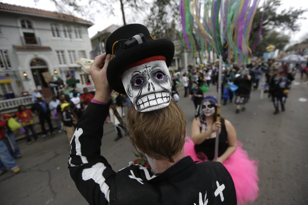 A reveler shows off his mask during the Krewe of Okeanos parade in New Orleans on Feb. 10, 2013.