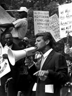 Attorney General Robert F. &quot;Bobby&quot; Kennedy uses a bullhorn to address a crowd of demonstrators, June 14, 1963, at the Justice Department. Four months earlier he had walked 50 miles in one day to prove to his brother John that he could do it. His march helped make extreme walking and hiking popular activities.
