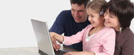 Family at laptop computer