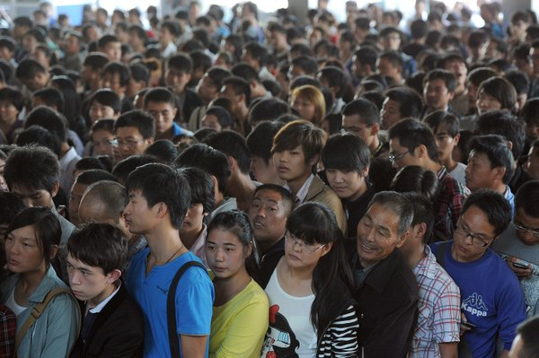 Thousands of travellers queue up at a railway station in China's Anhui province to catch trains ahead of National Day holiday, 2012.