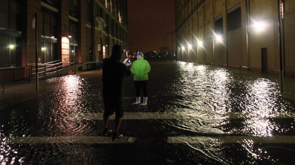 Picture-takers were out Monday night in Manhattan, where some streets were flooded.