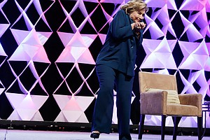 VIDEO: Woman Throws Shoe At Hillary Clinton, No Harm Done