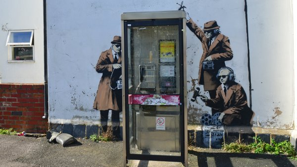 Suspected Banksy art work appears on the side of a house depicting government...