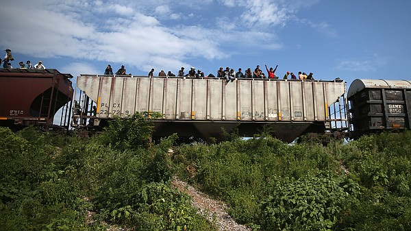 Migrants arrive at a rest stop in Ixtepec, Mexico, after ...