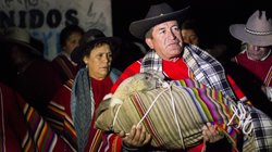 The mayor of Coyllurqui, Walter Bocangel Gamarra, carries the bundled condor ...