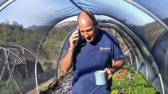Coco Savvy owner John Clemons in his greenhouse.