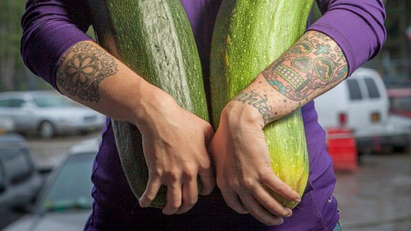Alaska grower Brittney Kauffman holds two zucchinis she e...
