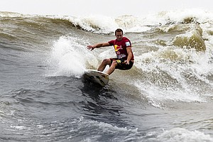 Riding The 'Silver Dragon,' Surfers Tame China's 10-Foot River Waves