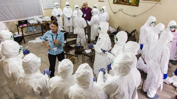A World Health Organization worker trains nurses how to u...
