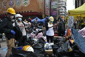 Hong Kong Police Arrest Protest Leaders, More Than 100 Ot...
