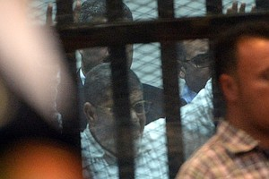 Egypt's Former President Morsi Sentenced To 20 Years In P...