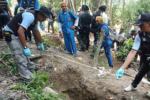 30 Graves, Thought To Be Burmese Migrants, Found In Thailand