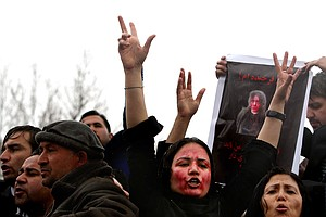 Judge Sends 11 Afghan Policemen To Prison Over Mob Killing Of Woman