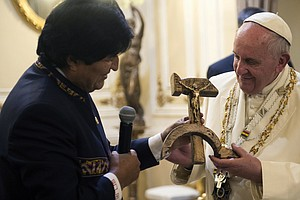 Bemused Or Irritated? Pope Reacts To Gift Of 'Communist C...