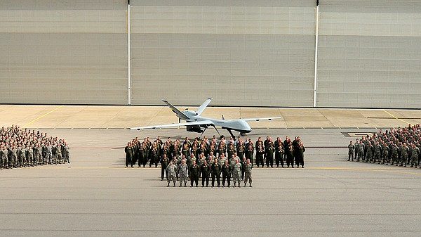 The Tennessee National Guard 118th Wing poses with a MQ-9...