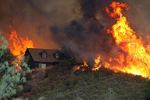 Wildfires In California Spur Emergency Declaration; 1 Firefighter Dead
