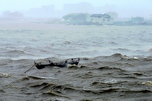 Typhoon Hits Chinese Coast After Sweeping Over Taiwan