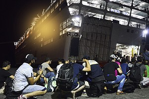 Migrants And Refugees Find Temporary Shelter On Greek Ferry