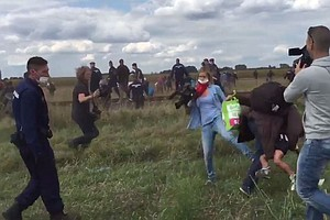 Camerawoman Who Tripped Migrant In Hungary Apologizes