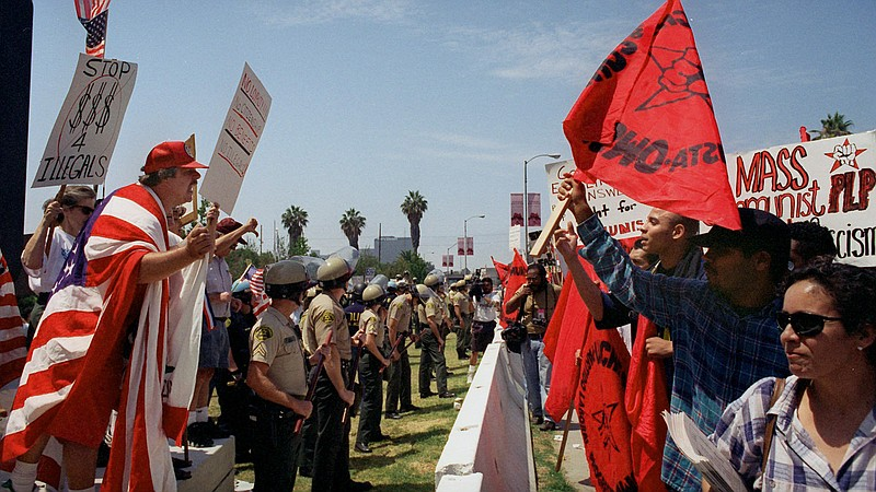 Activists for and against Proposition 187 rallied in Los Angeles in 1996, aft...