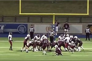 A High School Kicker Accidentally Hits Ref In The Head, M...