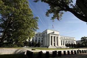 Fed Leaves Record-Low Interest Rates Unchanged