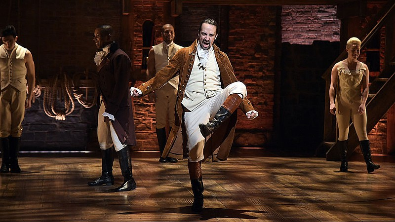 Actor and composer Lin-Manuel Miranda (center) performs on stage during a reh...