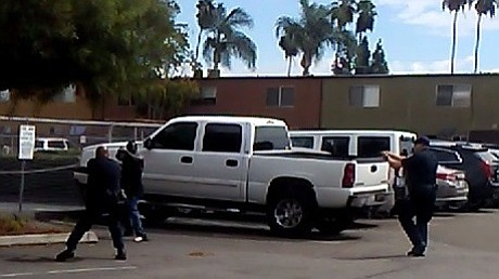 El Cajon police officers confront Alfred Olango in the pa...