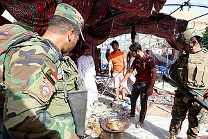 Suicide Bomber Targets Shiites In Baghdad, Killing At Lea...