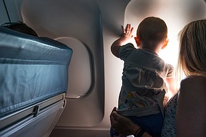 For Babies On A Plane, Hot Drinks And Co-Sleeping Pose A Risk