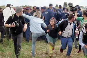 Hungarian Camerawoman Caught Kicking Migrants Is Sentence...