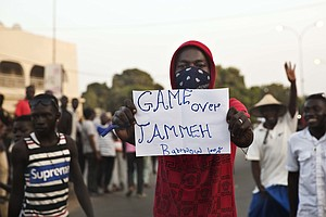Troops Poised To Remove Gambia's Leader Amid Last-Ditch N...